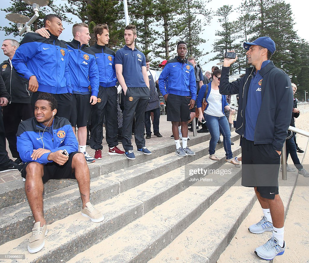 <a gi-track='captionPersonalityLinkClicked' href=/galleries/search?phrase=Rio+Ferdinand&family=editorial&specificpeople=157538 ng-click='$event.stopPropagation()'>Rio Ferdinand</a> of Manchester United films his teammates as they visit Manley Beach as part of their pre-season tour of Bangkok, Australia, China, Japan and Hong Kong on July 19, 2013 in Sydney, Australia.