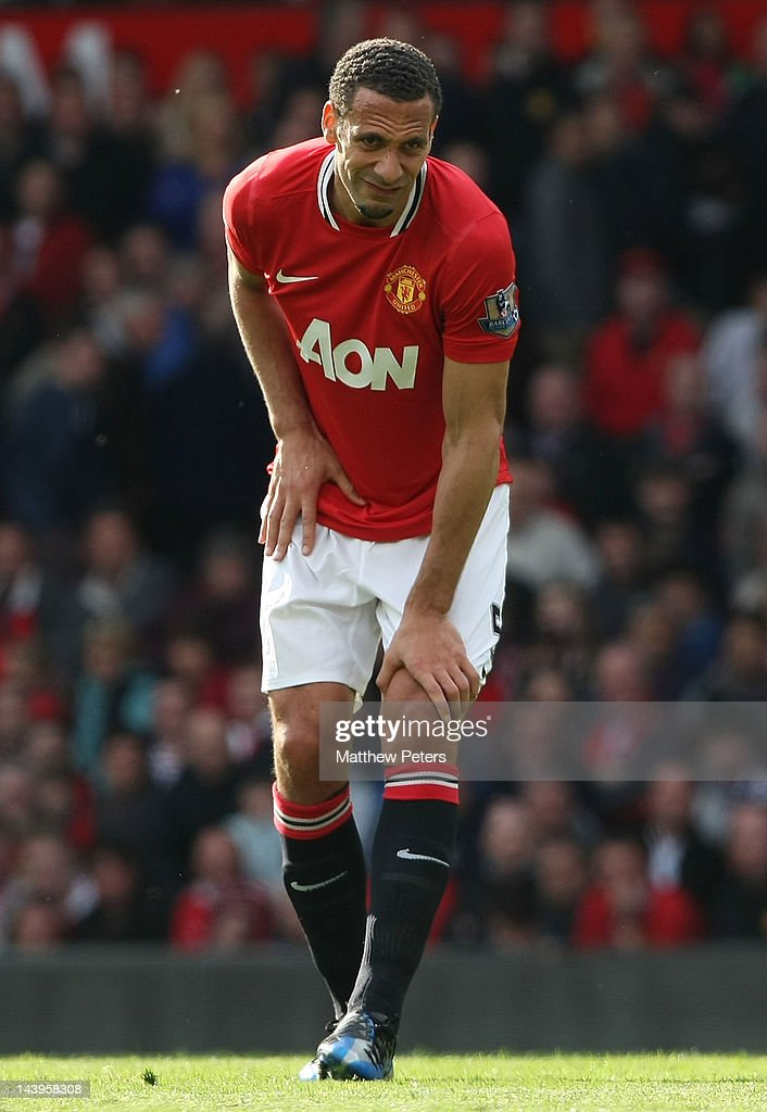 Rio Ferdinand of Manchester United holds an injured knee during the Barclays Premier League match between Manchester United and Swansea City at Old Trafford on May 6, 2012 in Manchester, England.
