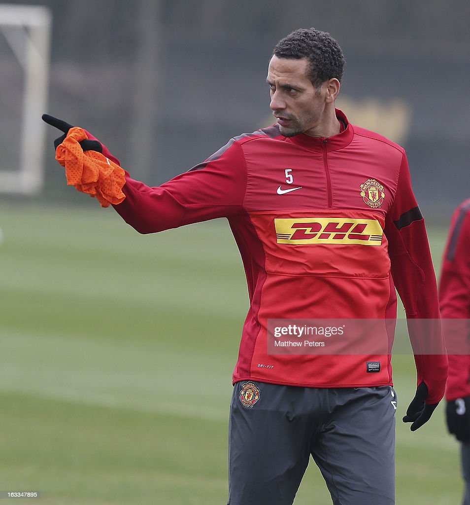 Rio Ferdinand of Manchester United in action during a first team training session at Carrington Training Ground on March 8, 2013 in Manchester, England.