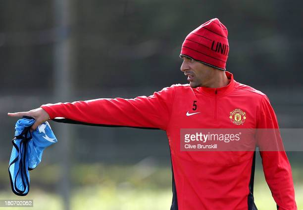 Rio Ferdinand of Manchester United in action during a first team training session ahead of their UEFA Champions League match against Bayer Leverkusen...