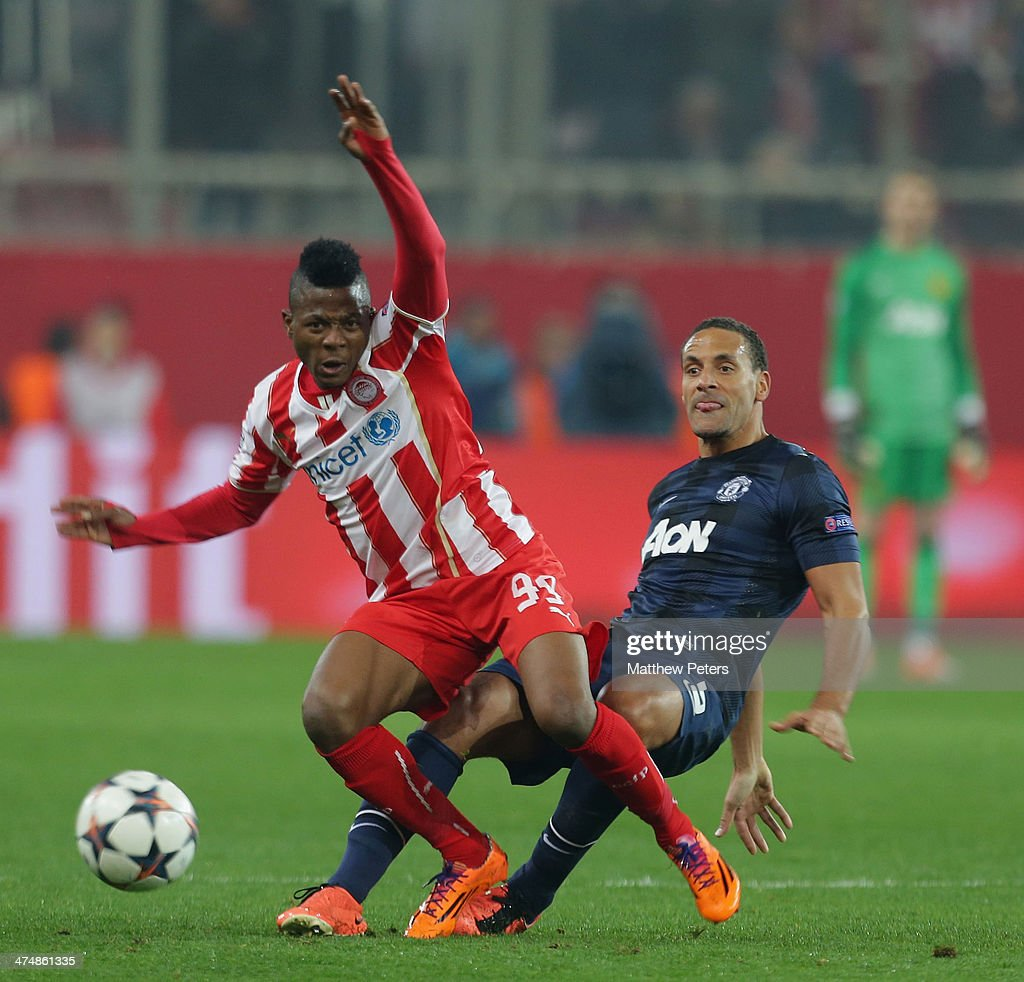 Rio Ferdinand of Manchester United in action with Michael Olaitan of Olympiacos FC during the UEFA Champions League Round of 16 match between Olympiacos FC and Manchester United at Karaiskakis Stadium on February 25, 2014 in Piraeus, Greece.