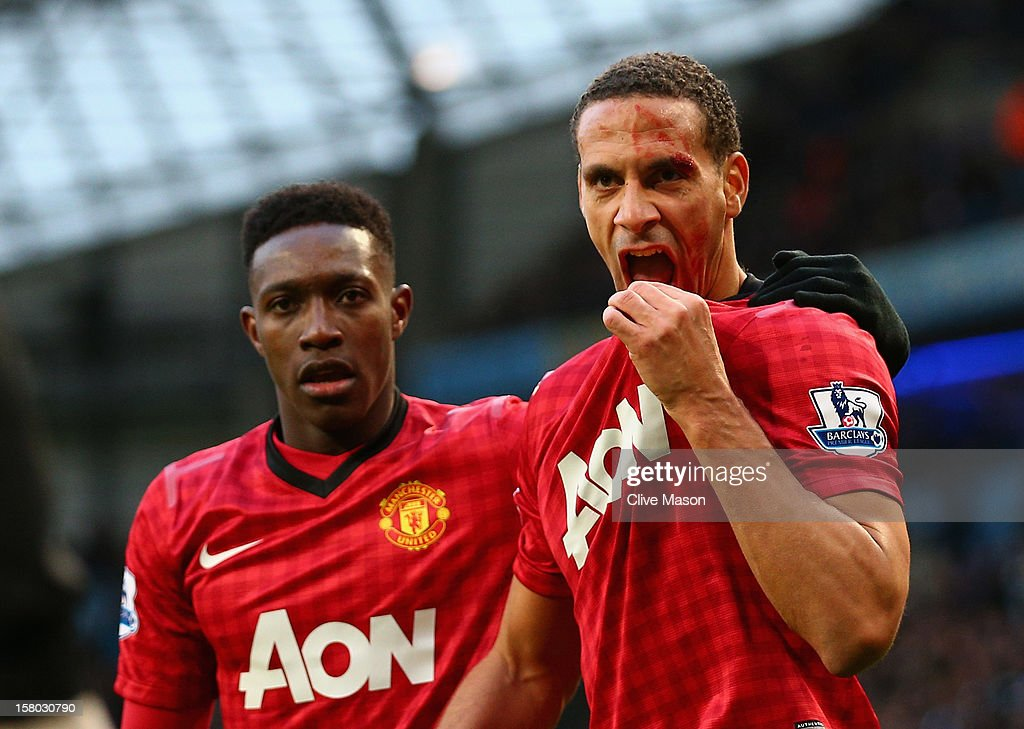 <a gi-track='captionPersonalityLinkClicked' href=/galleries/search?phrase=Rio+Ferdinand&family=editorial&specificpeople=157538 ng-click='$event.stopPropagation()'>Rio Ferdinand</a> of Manchester United is helped by team-mate <a gi-track='captionPersonalityLinkClicked' href=/galleries/search?phrase=Danny+Welbeck&family=editorial&specificpeople=4223930 ng-click='$event.stopPropagation()'>Danny Welbeck</a> (L) after being struck by an object during the Barclays Premier League match between Manchester City and Manchester United at Etihad Stadium on December 9, 2012 in Manchester, England.