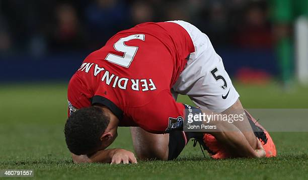 Rio Ferdinand of Manchester United lies injured during the FA Cup Third Round match between Manchester United and Swansea City at Old Trafford on...