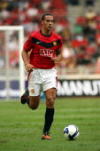Rio Ferdinand of Manchester United runs with the ball during the preseason friendly match between Manchester United and Malaysia XI at the Bukit...