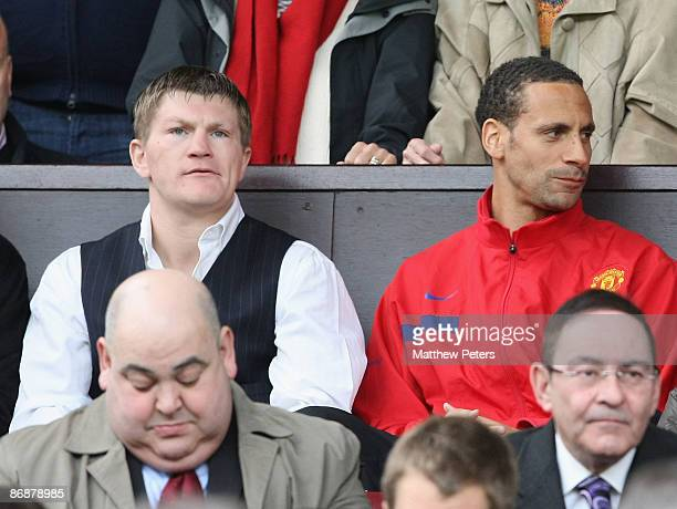 Rio Ferdinand of Manchester United sits with boxer Ricky Hatton in the directors' box during the Barclays Premier League match between Manchester...