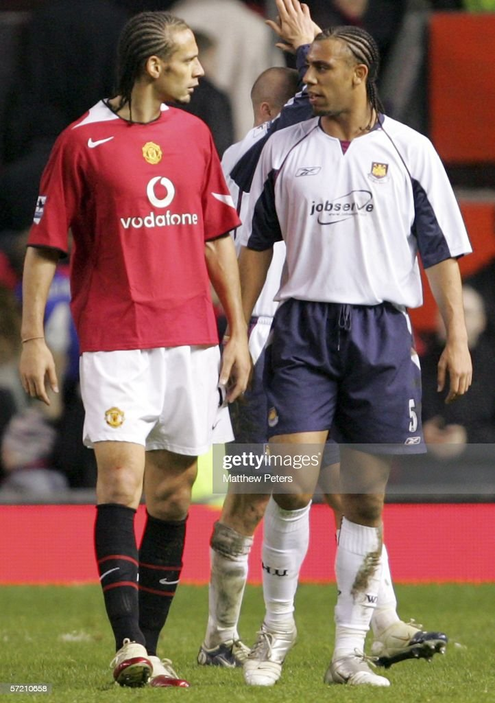 Rio Ferdinand of Manchester United talks with his brother Anton Ferdinand of West Ham United after the Barclays Premiership match between Manchester United and West Ham United at Old Trafford on March 29 2006 in Manchester, England.