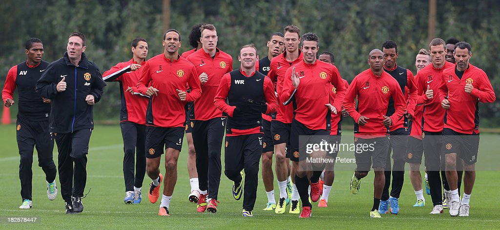 Rio Ferdinand, Phil Jones, Wayne Rooney, Jonny Evans, Robin van Persie, Ashley Young and Ryan Giggs of Manchester United in action during a first team training session, ahead of their UEFA Champions League match against Shaktar Donetsk, at Aon Training Complex on October 1, 2013 in Manchester, England.