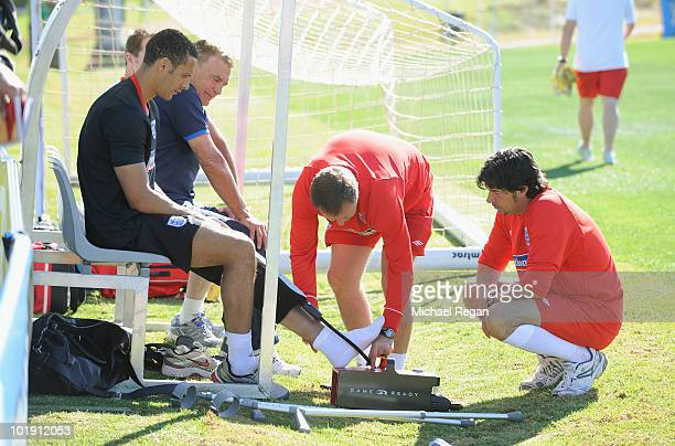 Rio Ferdinand receives treatment during the England training session at the Royal Bafokeng Sports Campus on June 9 2010 in Rustenburg South Africa