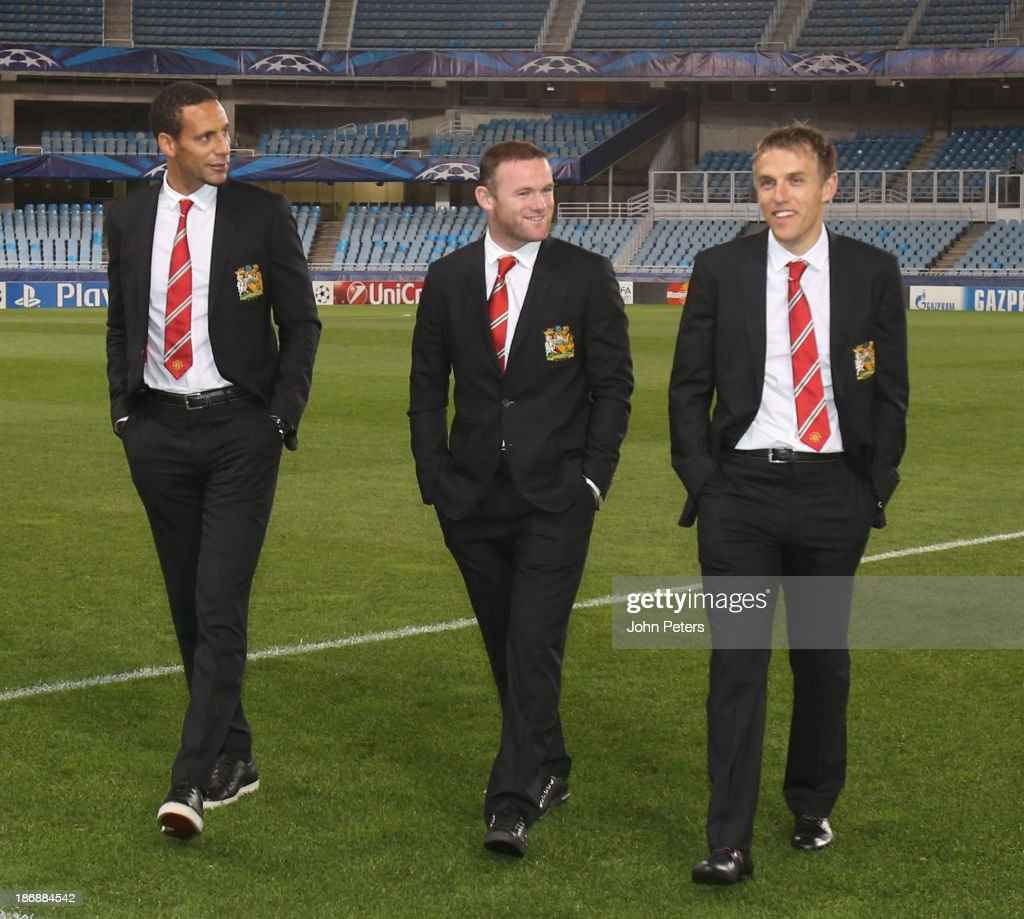 Rio Ferdinand, Wayne Rooney and coach Phil Neville of Manchester United inspect the pitch, ahead of their UEFA Champions League Group A match against Real Sociedad, at Estadio Anoeta on November 4, 2013 in San Sebastian, Spain.