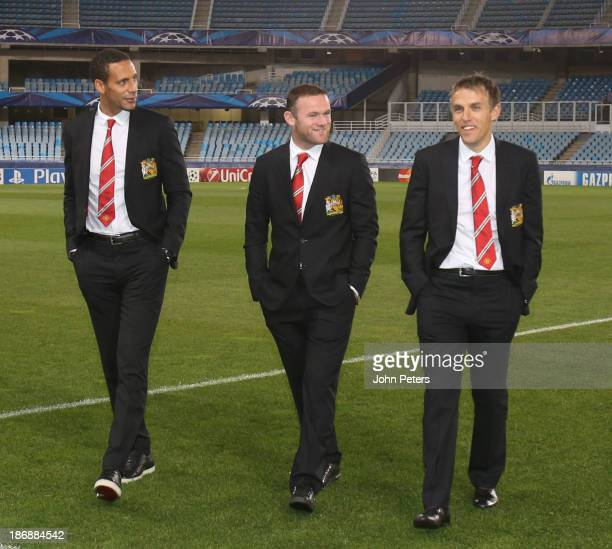 Rio Ferdinand Wayne Rooney and coach Phil Neville of Manchester United inspect the pitch ahead of their UEFA Champions League Group A match against...