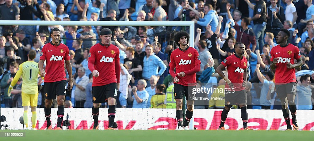 Rio Ferdinand, Wayne Rooney, Patrice Evra, Marouace Fellaini and Danny Welbeck of Manchester United react to conceding a goal during the Barclays Premier League match between Manchester City and Manchester United at the Etihad Stadium on September 22, 2013 in Manchester, England.