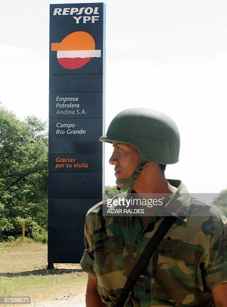 A Bolivian soldier stands guard at the entrance of the Spanish Repsol YPF gas and oil refinery Rio Grande Santa Cruz taken 04 May 2006 Spanish energy...