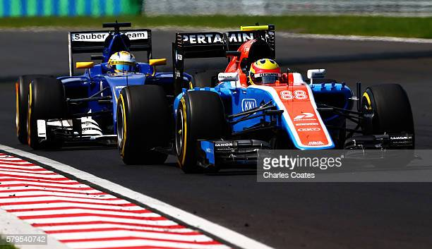 Rio Haryanto of Indonesia driving the Manor Racing MRTMercedes MRT05 Mercedes PU106C Hybrid turbo leads Marcus Ericsson of Sweden driving the Sauber...