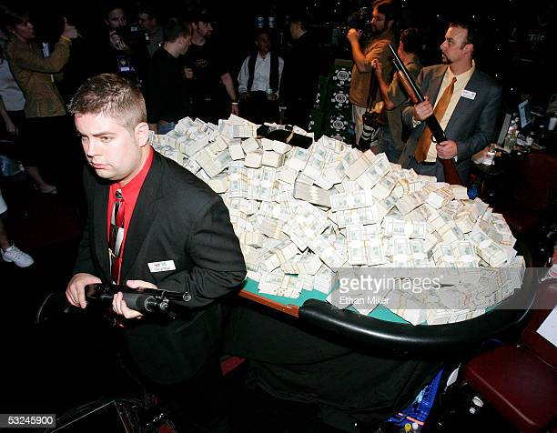 Rio Hotel and Casino security guards Dave Greger and Joe Howard guard the $75 million prize on display during the final day of competition at the...