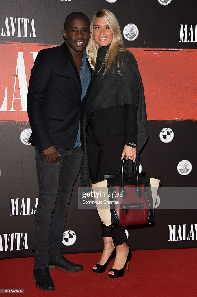 Rio Mavuba and Elodie Mavuba attend the 'Malavita' premiere at Europacorp Cinema on October 16, 2013 in Roissy-en-France, France.