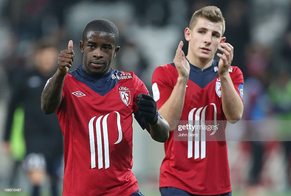 Rio Mavuba and Lucas Digne of LOSC thanking their supporters after the French Ligue 1 match between Lille OSC and Toulouse FC at the Grand Stade Lille Metropole on December 11, 2012 in Lille, France.