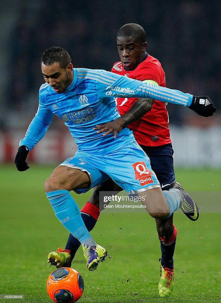 Rio Mavuba of Lille and Dimitri Payet of Marseille battle for the ball during the Ligue 1 match between LOSC Lille and Olympique de Marseille held at Stade Pierre-Mauroy on December 3, 2013 in Lille, France.
