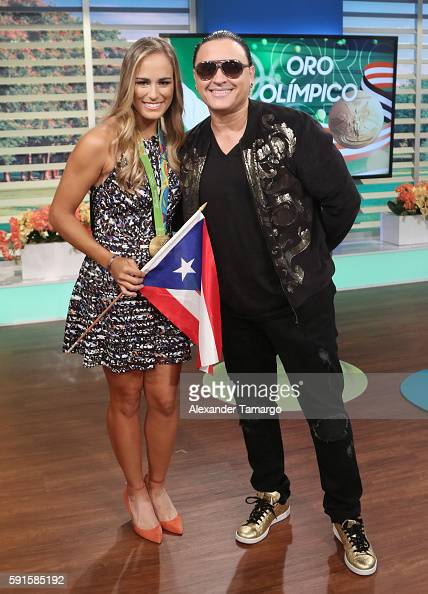 Rio Olympics 2016 Women's Singles Tennis Gold medalist Monica Puig of Puerto Rico and Elvis Crespo are seen on the set of 'Un Nuevo Dia' at Telemundo...