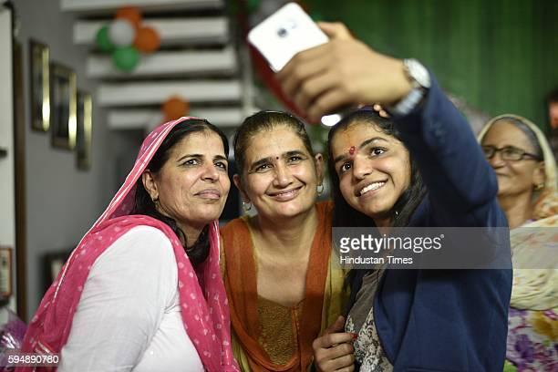 Rio Olympics bronze medallist Sakshi Malik clicking selfie with her family members on August 24 2016 in Rohtak India Sakshi Malik won the bronze...