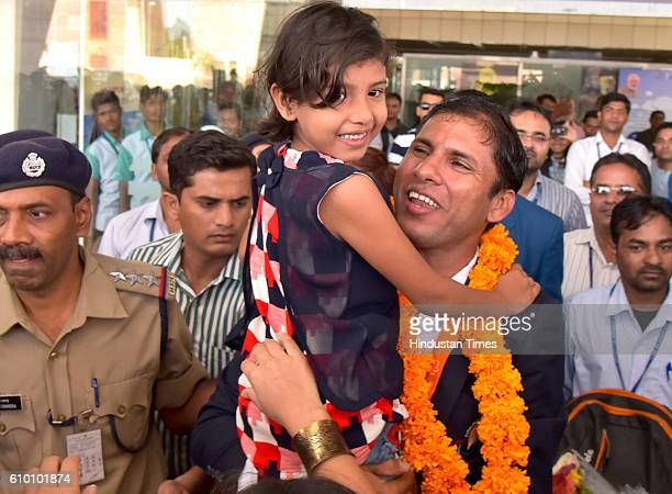 Rio Paralympics Gold medallist Devendra Jhajharia with his daughter and family members at Jaipur International Airport on 24 September 2016 in Jaipur...