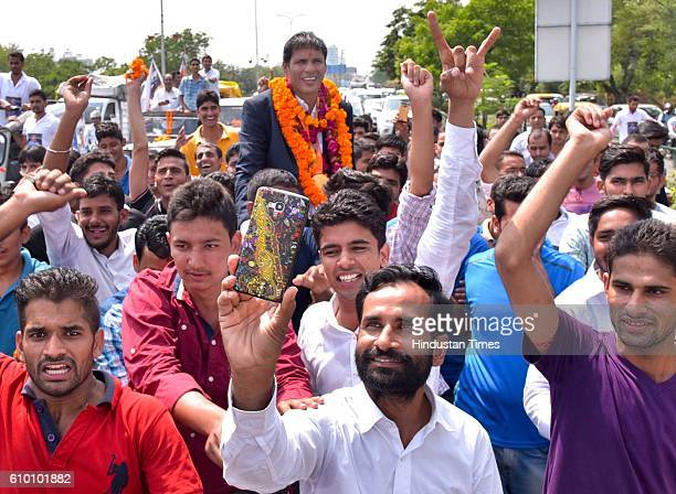 Rio Paralympics Gold medallist Devendra Jhajharia with his supporters at Jaipur International Airport on 24 September 2016 in Jaipur India Jhajharia...