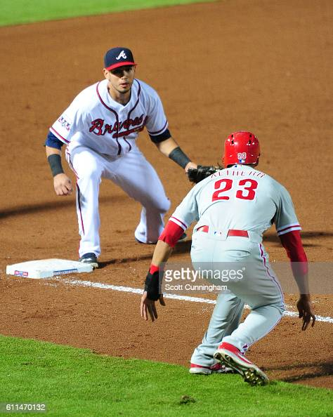 Rio Ruiz of the Atlanta Braves catches Aaron Altherr of the Philadelphia Phillies in a fifth inning rundown at Turner Field on September 29 2016 in...