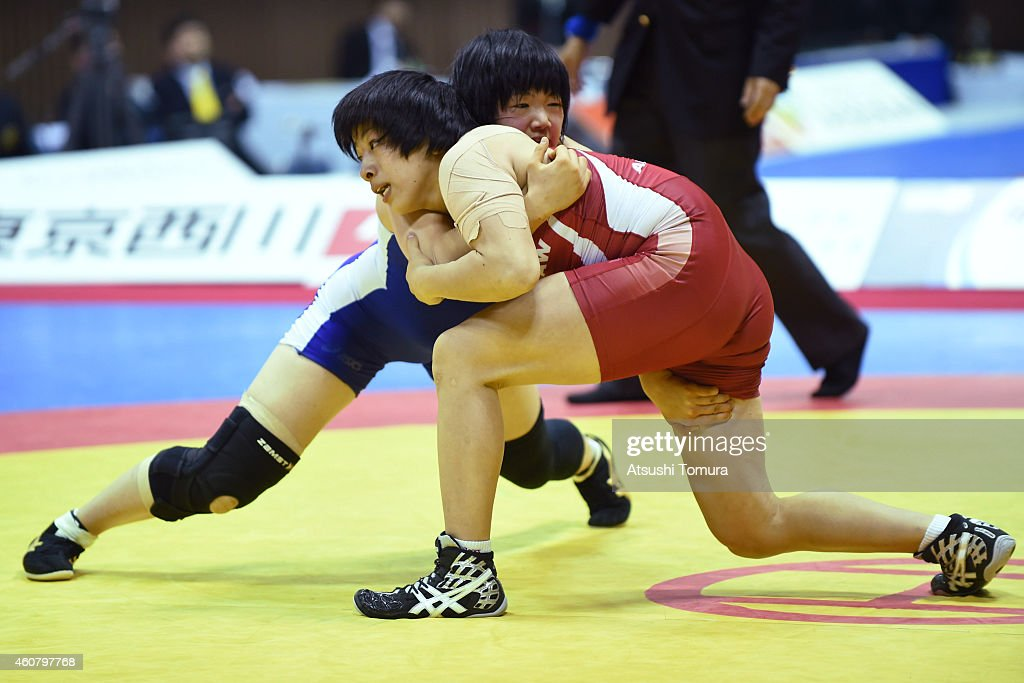Rio Watari (Red) and Yurika Ito (Blue) compete in Women's 63kg free style final match during 2014 Emperor's Cup All Japan Wresting Championship on December 23, 2014 in Tokyo, Japan.