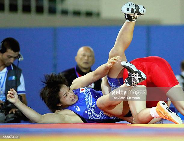 Rio Watari of Japan and Battsetseg Soronzonbold of Mongolia compete in the Women's 63kg first round during day five of the FILA World Wrestling...
