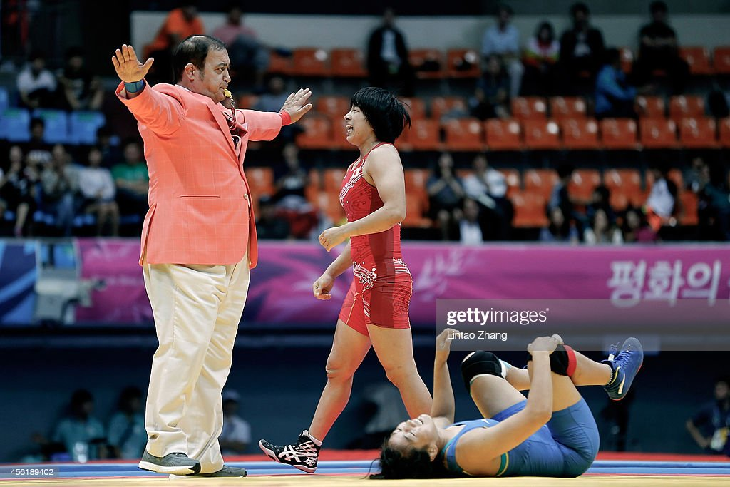 Rio Watari (C) of Japan reacts after win gold in the Wrestling Women's Freestyle 63 kg Gold Medal Final against Xiluo Zhuoma of China during day eight of the 2014 Asian Games at Dowon Gymnasium on September 27, 2014 in Incheon, South Korea.