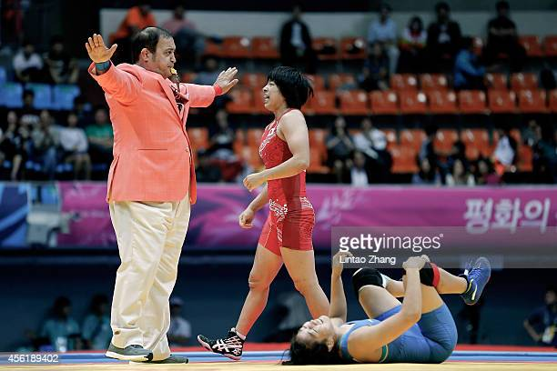 Rio Watari of Japan reacts after win gold in the Wrestling Women's Freestyle 63 kg Gold Medal Final against Xiluo Zhuoma of China during day eight of...