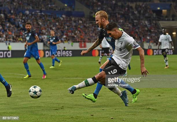 Rioberto Firmino of Liverpool with Kevin Vogt of TSG 1899 during the UEFA Champions League Qualifying PlayOffs Round First Leg match between 1899...