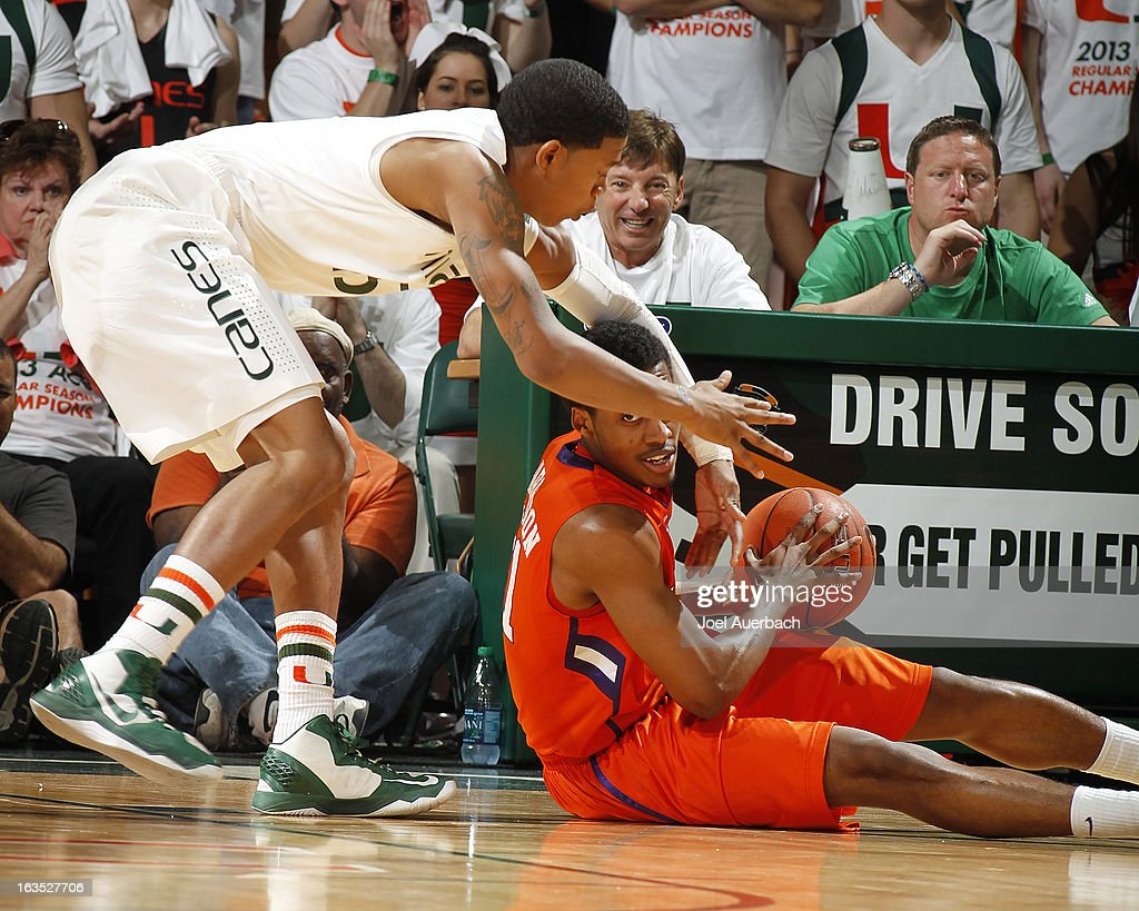 Rion Brown #15 of the Miami Hurricanes and Damarcus Harrison #21 of the Clemson Tigers battle for the ball on March 9, 2013 at the BankUnited Center in Coral Gables, Florida. The Hurricanes defeated the Tigers 62-49 and won the Atlantic Coast Conference Championship.