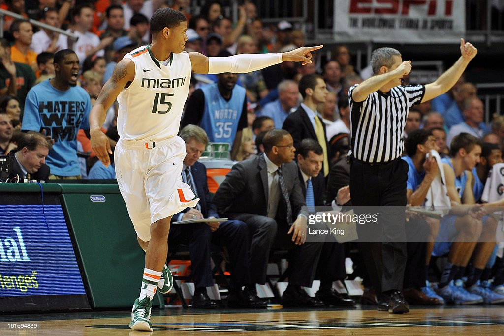 Rion Brown #15 of the Miami Hurricanes points to a teammate against the North Carolina Tar Heels at the BankUnited Center on February 9, 2013 in Coral Gables, Florida. Miami defeated North Carolina 87-61.