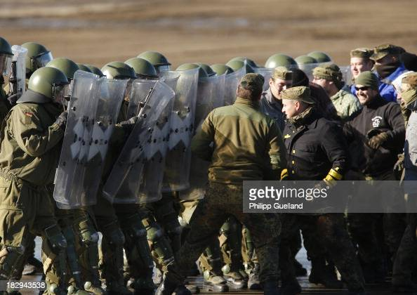 A riot control unit of the German military Police advances against mock rioters during the annual military exercises held for the media at the Bergen...