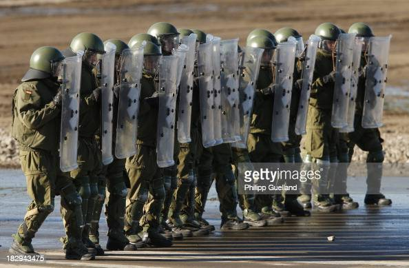 A riot control unit of the German military Police advances during the annual military exercises held for the media at the Bergen military training...