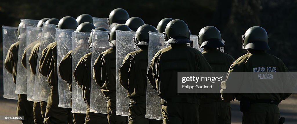 A riot control unit of the German military Police (Feldjaeger) marches during the annual military exercises held for the media at the Bergen military training grounds on October 2, 2013 near Munster, Germany. The Bundeswehr is transitioning to a professional army as Germany recently ended mandatory military service.
