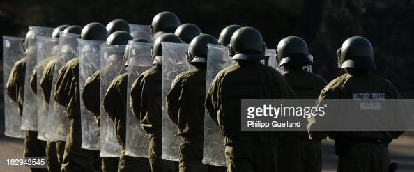 A riot control unit of the German military Police marches during the annual military exercises held for the media at the Bergen military training...