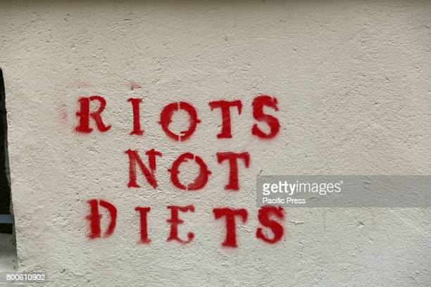 TüRKENSTRAßE MUNICH BAVARIA GERMANY 'Riot not Diet' tag on the wall near the protest Around 20 Christian fundamentalists demonstrated through Munich...