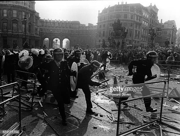 Riot police and anti poll tax demonstrators in Trafalgar square during the anti poll tax riots of April 1990 UK