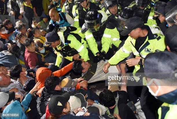 Riot police and demonstrators face each other on Sept 7 in Seongju southeast of Seoul where four additional Terminal High Altitude Area Defense...