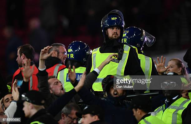 Riot police are depolyed to deal with fans clashing during the EFL Cup fourth round match between West Ham United and Chelsea at The London Stadium...