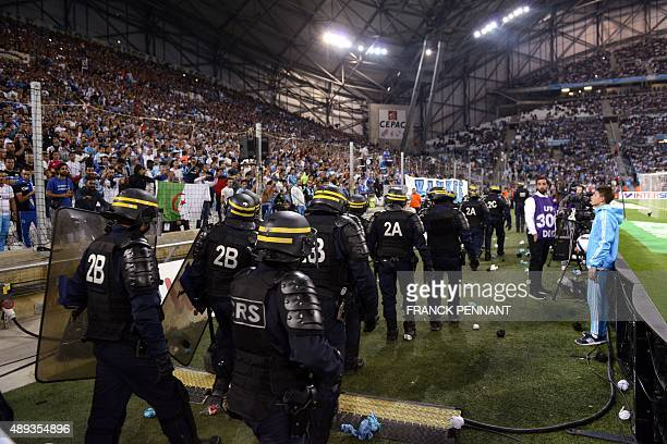 Riot police are pictured during a game interruption after crowd trouble during the French L1 football match Marseille vs Lyon on September 20 2015 at...