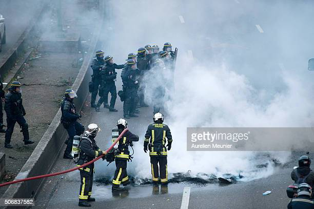 Riot police are protecting firefighters as taxis demonstrate by blocking the traffic on the peripherique by setting tires on fire on January 26 2016...