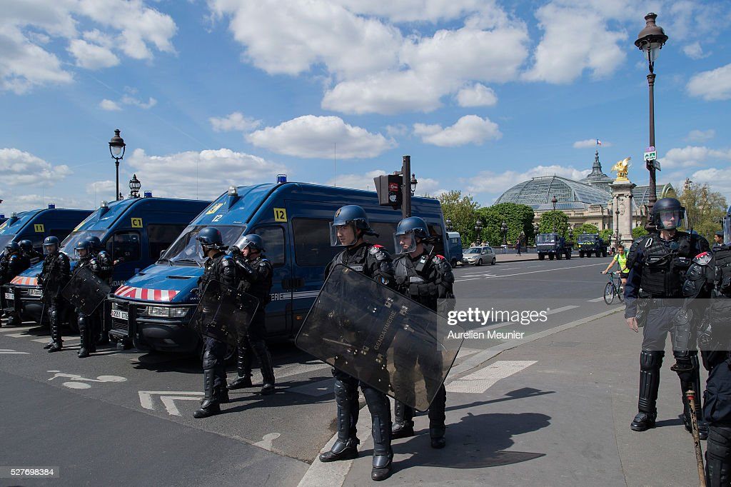 Riot police are securing an area as Paris students demonstrate against the 'El Khomri' law project at Les Invalides on May 3, 2016 in Paris, France. After weeks of contestation and several demonstrations, French Minister of Labor, Employment and Social dialogue, Myriam El Khomri presented her text for the 'El Khomeri' labor law project' in front of the National Assembly.