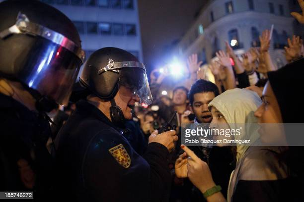 Riot police argue with protesters after a demonstration at Alcala Street on October 24 2013 in Madrid Spain The Spanish Parliament recently approved...