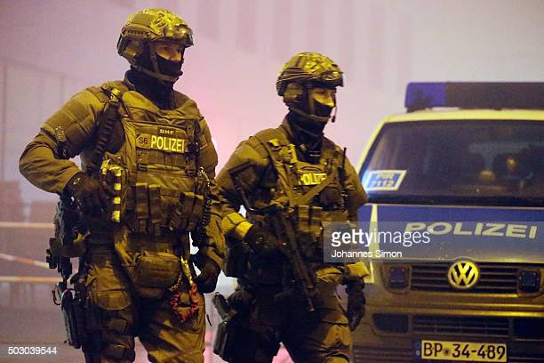 Riot police armed with machine guns controls the street in front of Pasing railway station on January 1 2016 in Munich Germany According to Joachim...