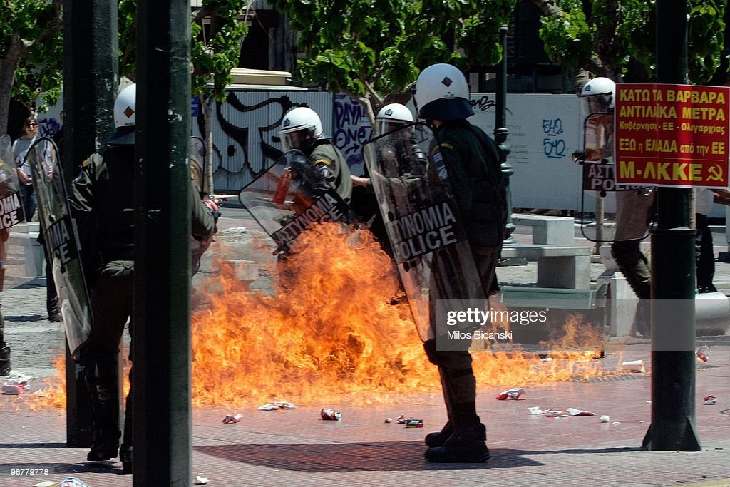 Riot police attempt to put out a fire during May Day protests on May 1, 2010 in Athens, Greece. Thousands of protesters gathered in Athens and other Greek cities to participate in May Day rallies, angered by the harsh austerity measures demanded by the EU. Reports suggest that the 45 billion euros ($60 billion) already pledged by the International Monetary Fund and European Union will be insufficient to tackle Greece's mounting debt crisis.