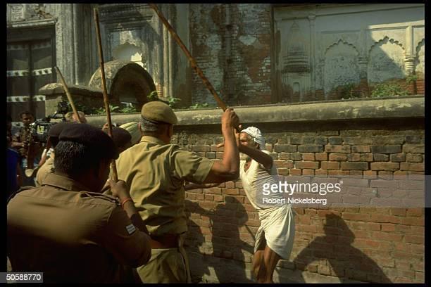Riot police battling rampaging incited Hindus bent on razing Muslim mosque Babri Masjid erecting Hindu temple to godking Rama