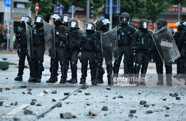 Riot police block a road on July 7 2017 in Hamburg northern Germany where leaders of the world's top economies gather for a G20 summit Protesters...