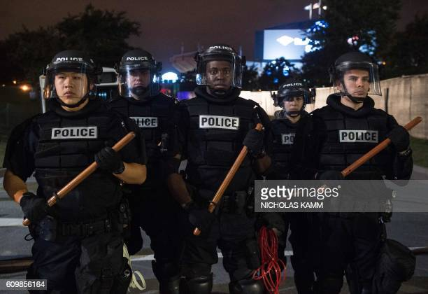 TOPSHOT Riot police block off a ramp to a highway during a demonstration against police brutality in Charlotte North Carolina on September 22 2016...